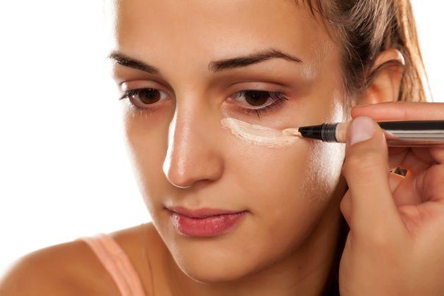 apply concealer to cover dark circle under eye