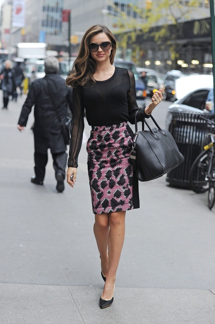 Miranda Kerr wearing boat neck top and mid-length dress in elegant style