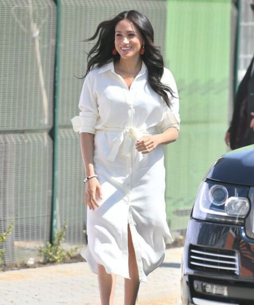 Meghan Markle wearing shirt dress on the Duchess of Sussex Royal tour in South Africa 2019